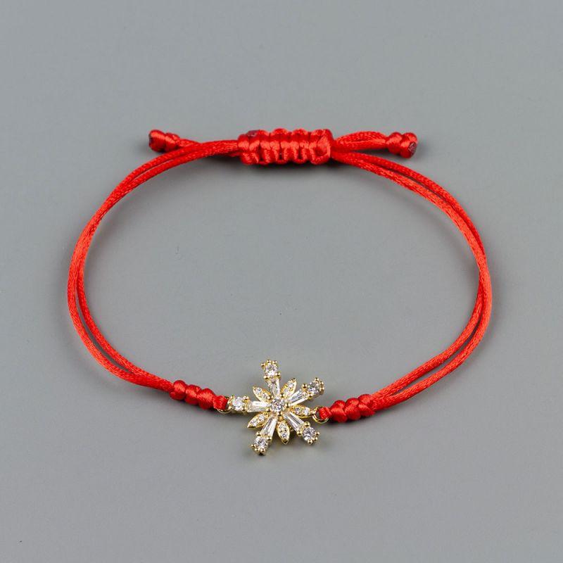 Дамска гривна от червен сатен и златна снежинка с кристали