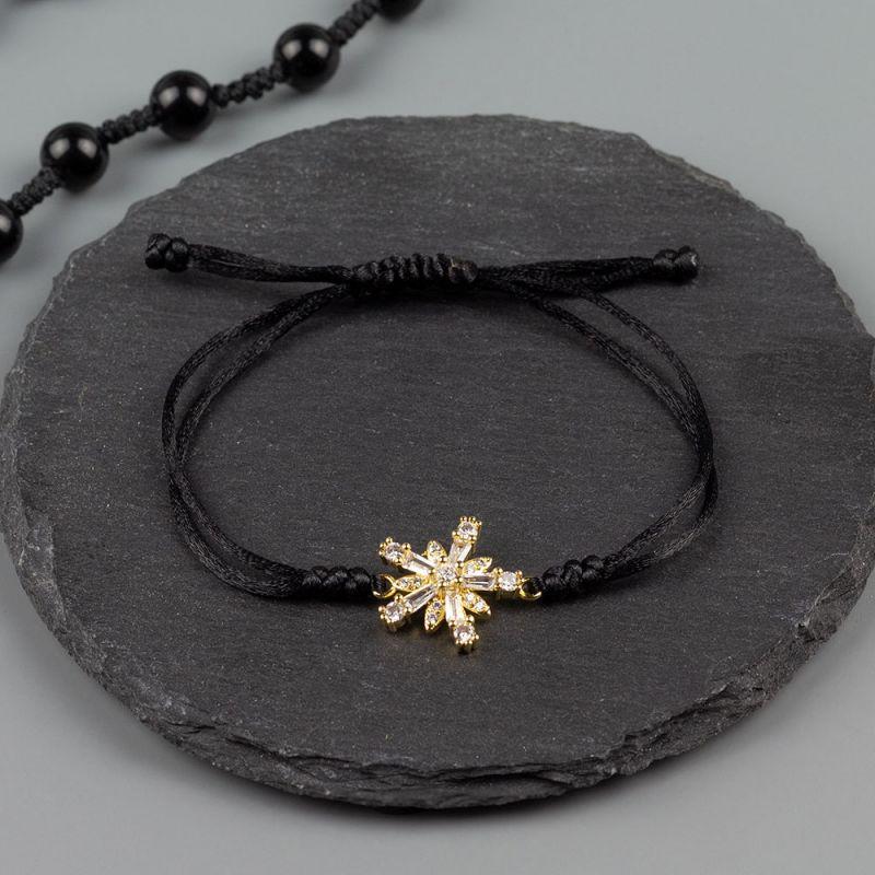 Дамска гривна от черен сатен и златна снежинка с кристали