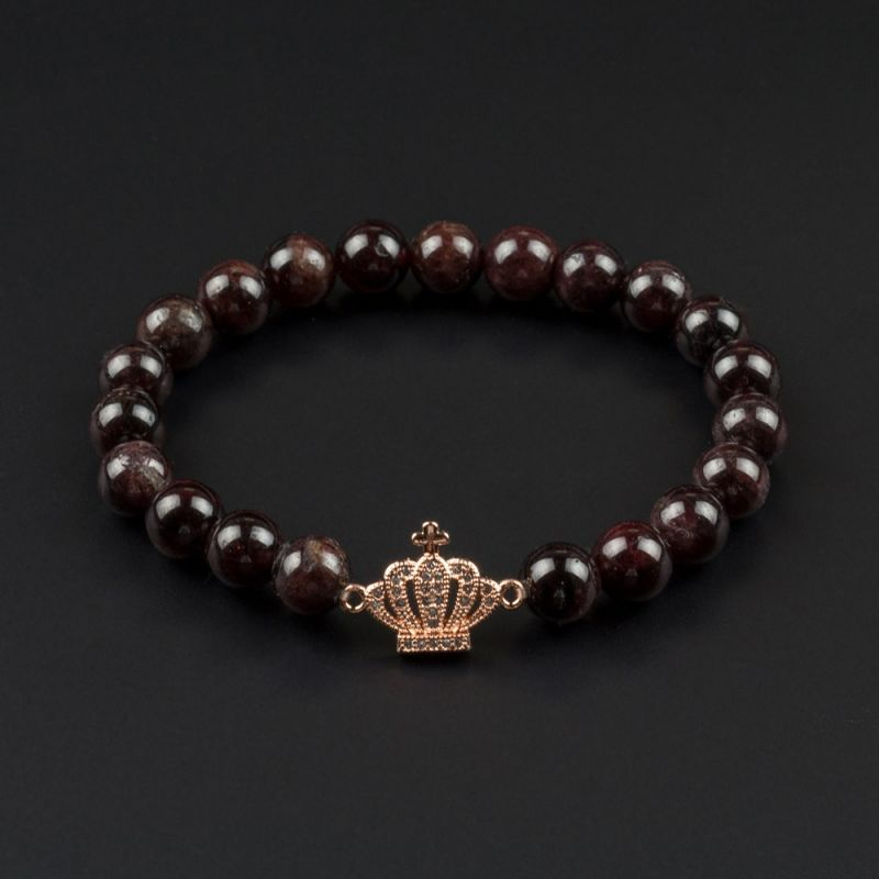Дамска гривна с елемент корона и камък Гранат