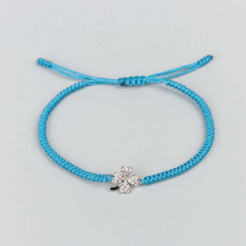Светло синя плетена гривна с елемент детелина