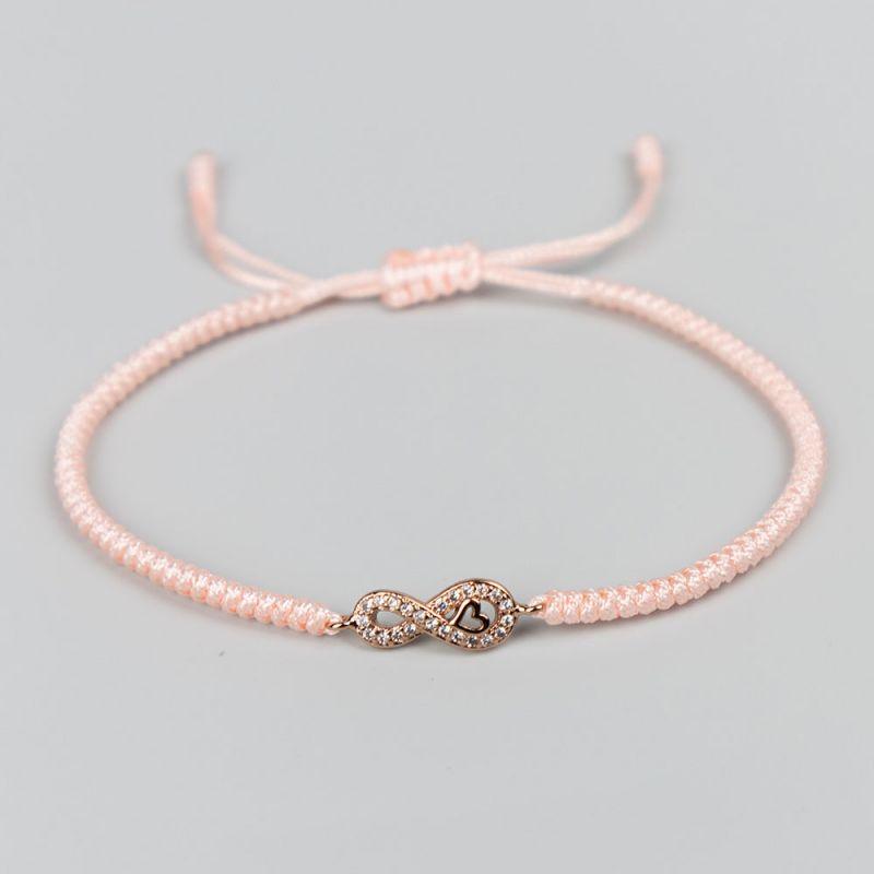 Розова плетена гривна с елемент безкрайност