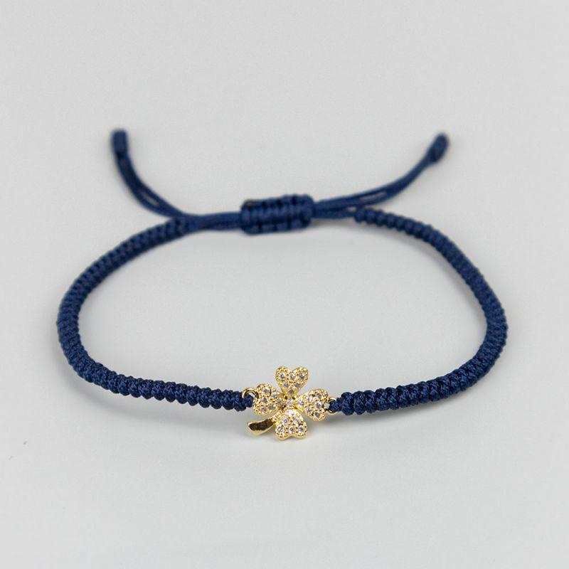 Тъмно синя плетена гривна с елемент детелина