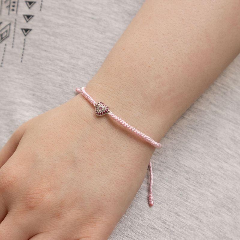 Розова плетена гривна с елемент сребристо сърце